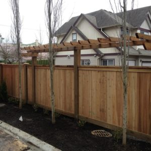 a cedar panel fence installation in Mission, BC